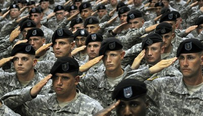FILE - This July 28, 2010 file photo shows soldiers from the 10th Mountain Division saluting during the National Anthem during a welcome home ceremony attended by Vice President Joe Bid