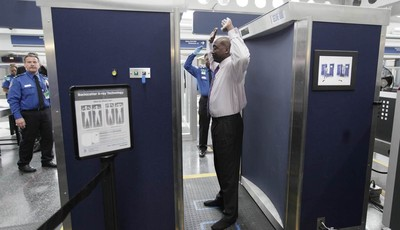 FILE - In this Monday, March 10, 2010 file photo, volunteers pass through the first full body scanner, which uses backscatter technology, installed at O