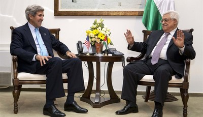 U.S. Secretary of State John Kerry, left, meets with Palestinian President Mahmoud Abbas inside Muqataa, the Palestinian Presidential compound in the West Bank town of Ramallah, on Sund