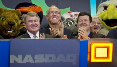Atlantic Coast Conference  commissioner John Swofford, far left, Syracuse basketball coach Jim Boeheim, second from left, NASDAQ head of listings Bob McCooey, second from right, and  Vi