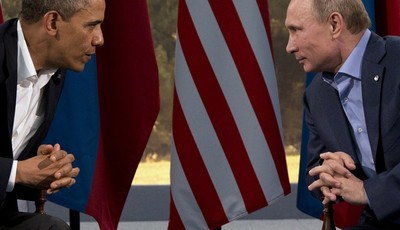 FILE - This June 17, 2013 file photo shows President Barack Obama meeting with Russian President Vladimir Putin in Enniskillen, Northern Ireland. President Barack Obama brushed aside sh
