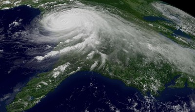 FILE - This Aug. 29, 2005 file photo provided by NOAA shows a satellite image of Hurricane Katrina. U.N. climate experts say global warming accelerated since the 1970s, breaking more co