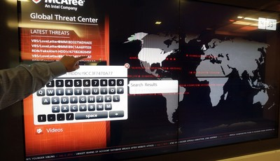 In July 3, 2013 photo, a global map tracks computer virus activity at the McAfee headquarters in Santa Clara, Calif. The hackers who knocked out tens of thousands of South Korean comput
