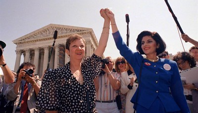 FILE - In this Wednesday, April 26, 1989 file photo, Norma McCorvey, Jane Roe in the 1973 court case, left, and her attorney Gloria Allred hold hands as they leave the Supreme Court bui