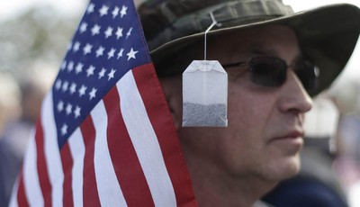 Tea bags hang from the hat of Steve Wandtke during a Guns Across America rally at the state capitol, Saturday, Jan. 19, 2013, in Austin. Texas officials opposed to new federal gun contr