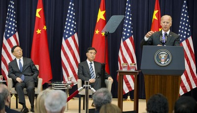 Chinese State Councilor Yang Jiechi, left, and Chinese Vice Premier Wang Yang, center, listen as Vice President Joe Biden speaks during the opening session of the 2013 Strategic and Eco