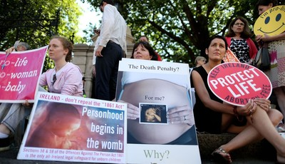 Anti-abortion campaigners wait outside the Irish Parliament at Leinster House, Dublin ahead of a parliamentary vote on abortion. Wednesday July 10, 2013. Irish politicians will vote Wed