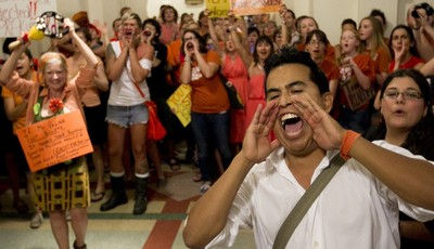Dave Cortez, right, and other abortion rights advocates scream outside the Senate Chamber during the debate of abortion restriction bill, Friday July 12, 2013, in the Capitol in Austin,
