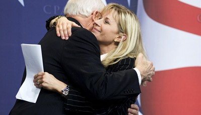 FILE - This Feb. 18, 2010 file photo shows Former Vice President Dick Cheney hugs his daughter, Liz Cheney, at the Conservative Political Action Conference (CPAC) in Washington. Liz Che