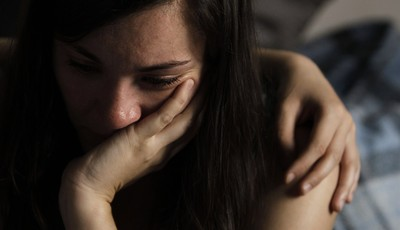 Amaya Munoz Garcia, 31 years old, cries as she receives support from a member of the Victims