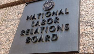 The sign for the National Labor Relations Board is seen on the building that houses their headquarters in downtown Washington, Wednesday, July 17, 2013. For such a tiny government agenc