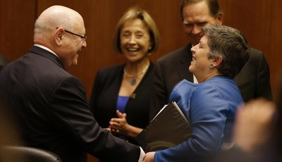 Homeland Security Secretary Janet Napolitano, right, laughs with University of California president Mark Yudof, left, following a University of California Board of Regents meeting Thurs