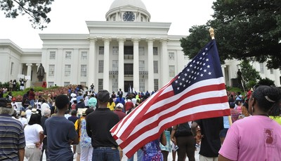 People gather in front of the Capitol during a rally, Saturday, July 20, 2013, in Montgomery, Ala. The Rev. Al Sharpton