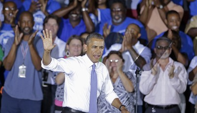 President Barack Obama waves  as he arrives to speak about the economy, Thursday, July 25, 2013, at the Jacksonville Port Authority in Jacksonville, Fla. A day after he kicked off the t