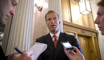 Sen. John Thune, R-S.D., chair of the Senate Republican Caucus, speaks with reporters just before the final vote on whether to reverse the recent hike in rates for government student lo