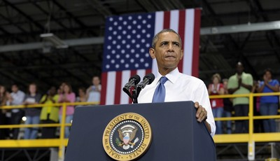 President Barack Obama speaks at the Amazon fulfillment center in Chattanooga, Tenn., Tuesday, July 30, 2013. Obama came to Chattanooga to give the first in a series of policy speeches