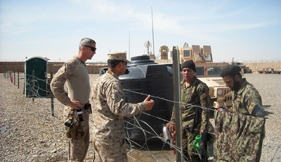 This photo taken March 22, 2013 shows U.S. Marine Maj. Chris Bourbeau, left, with the 1st Brigade, 215th Corps Afghanistan National Army Advisor Team, and a translator, at Camp Garmser,
