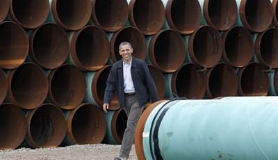 FILE - This March 22, 2012 file photo shows President Barack Obama arriving at the TransCanada Stillwater Pipe Yard in Cushing, Okla. Obama has revived debate about the number of jobs t