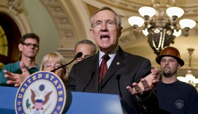 FILE - In this Aug. 1, 2013 file photo, Senate Majority Leader Harry Reid of Nev. speaks on Capitol Hill in Washington. The accomplishments are few, the chaos plentiful in the 113th Con
