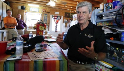 Gov. Phil Bryant, shown In this Aug. 1, 2013 photograph taken during a media sitdown at the Neshoba County Fair in Philadelphia, Miss., says  a new state law that says authorities must
