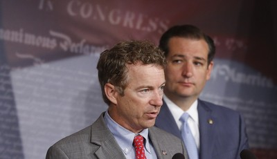 FILE - In this July 16, 2013 file photo Republican Sens. Rand Paul of Kentucky, and Ted Cruz of Texas take part in a news conference on Capitol Hill in Washington. About two months ago