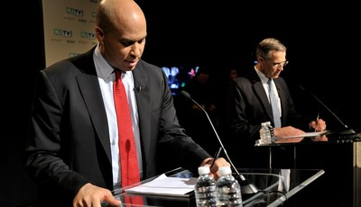In this photo provided by NJTV, Newark Mayor Cory Booker, left, and Rep. Rush Holt prepare for the U.S. Senate Democratic Primary debate televised on NJTV from Montclair State Universit