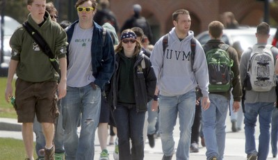 FILE - In this April 30, 2012, file photo, students walk across campus at the University of Vermont in Burlington, Vt.  UVM was ranked nineteenth on the best party school list. College