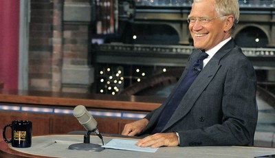 "FILE - In this July 16, 2013 file photo, host David Letterman smiles on the set of the ""Late Show with David Letterman."" A study released Monday of gags made by late-night comics found"