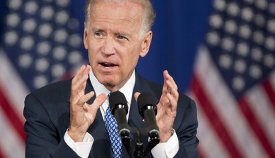 FILE - In this July 18, 2013 file photo, Vice President Joe Biden speaks in Washington. Biden plans to raise campaign cash for the Democratic leader of the first-in-the-nation primary s