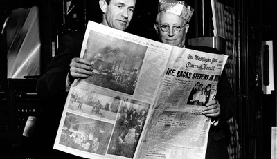 In this March 18, 1954 photo, Philip L. Graham, left, and Eugene Meyer look at the first The Washington Post Times Herald, in Washington. Amazon.com founder Jeff Bezos struck a deal Mon