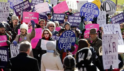 Abortion rights advocates shout during a rally in Capitol Square in Richmond, Va., Tuesday, Jan. 22, 2013, marking the 40th anniversary Tuesday of the landmark U.S. Supreme Court ruling