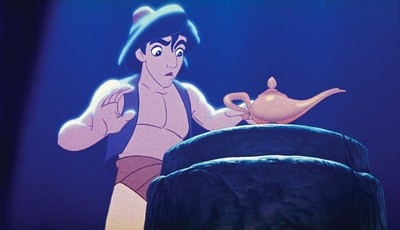 """This undated publicity photo provided by Disney Theatrical Productions shows Aladdin with a lamp in a scene from the 1992 animated film, """"Aladdin."""" A stage musical of """"Aladdin"""" is ridin"""