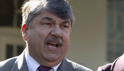 FILE - This Nov. 13, 2012 file photo shows AFL-CIO President Richard Trumka speaking to reporters outside the White House in Washington. The nation