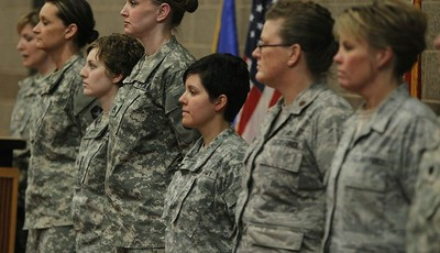 Kristen Auge, Deputy Director of Public Affairs, introduces soldiers from left, Army Sgt. 1st Class Katie Reed, Army Sgt. Cassie Mecuk, Army Staff Sgt. Andrea Drost, Army Sgt. Katie War