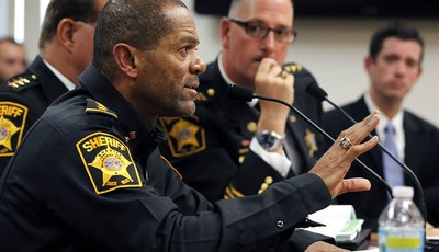 FILE - In this Oct. 11, 2012 file photo, Milwaukee County Sheriff David Clarke talks during a budget hearing in Milwaukee, Wis. The Wisconsin sheriff said he released an ad calling on r