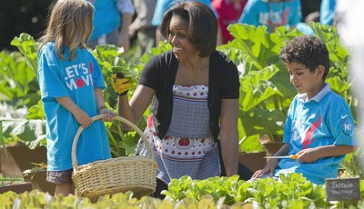 "FILE - In this June 3, 2011, file photo, first lady Michelle Obama tends the White House garden in Washington, with a group of children as part of the ""Let"
