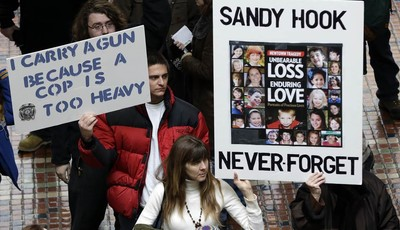 Gun rights and gun control advocates demonstrate in the Pennsylvania Capital building Wednesday, Jan. 23, 2013, in Harrisburg, Pa. As a boycott continued to grow over a ban on assault w