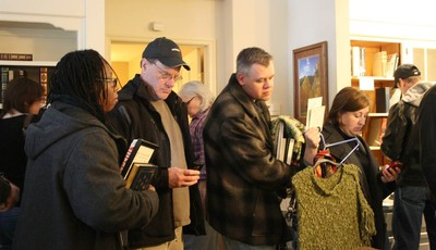 People wait in line for buy items during a two-day estate sale at former U.S. Sen. George McGovern