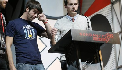 """Director Steve Hoover, right, and documentary subject Rocky Braat, left, accept the Grand Jury Prize: U.S. Documentary for """"Blood Brother"""" during the 2013 Sundance Film Festival Awards"""