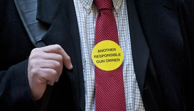 Jeff Soracco of Oxford, Conn. wears a sticker identifying him as a responsible gun owner as he waits to sign up to speak at a hearing of a legislative subcommittee reviewing gun laws at