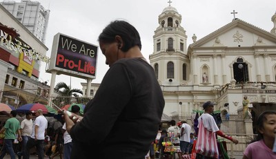 "A ""Pro-Life"" sign flashes on an electric signboard outside the Roman Catholic Minor Basilica of the Black Nazarene in downtown Manila, Philippines on Thursday, Jan. 3, 2013. Philippine"