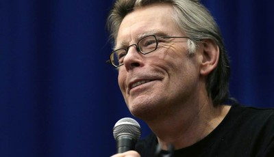 FILE - This Dec. 7, 2012 file photo shows novelist Stephen King speaking to creative writing students at the University of Massachusetts-Lowell in Lowell, Mass. A signed copy of a rare