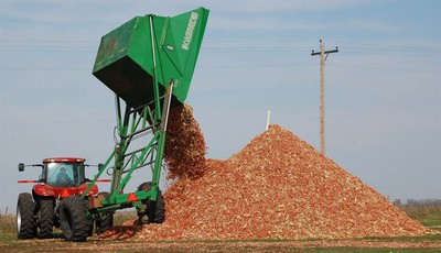FILE - In this Oct. 30, 2007 file photo, a dump wagon adds freshly gathered corn cobs to a pile on a farm near Hurley, S.D. After decades of talk, the ethanol industry is building multi