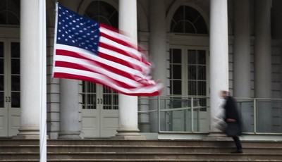 The American flag flies at half-staff outside City Hall to honor the death of former New York City Mayor Ed Koch, Friday, Feb. 1, 2013, in New York. Koch, the combative politician who r