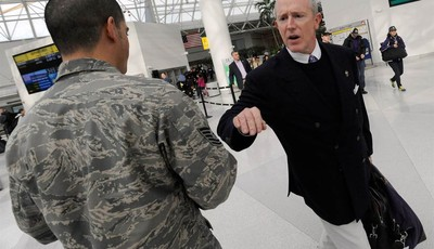 David Modell, son of the late Art Modell, former Baltimore Ravens NFL football team owner, greets a member of the Air Force at Baltimore-Washington International Thurgood Marshall Airpo
