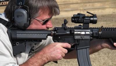In this Tuesday, Feb. 5, 2013 photo, a shell is ejected as Frankie McRae fires an AR-15 semiautomatic rifle at his Range 37 gun club in Bunnlevel, N.C. McRae says U.S. Sen. Dianne Feins