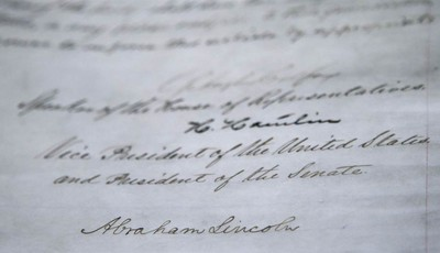 The signature of President Abraham Lincoln is seen on the 13th Amendment in a display at the Tennessee State Museum on Monday, Feb. 11, 2013, in Nashville, Tenn. The 13th Amendment, whi