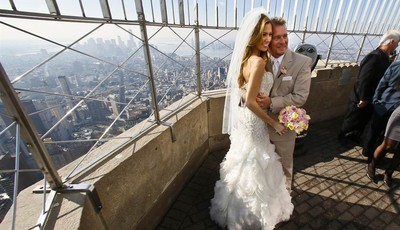 Newlyweds Danielle Brabham, 39, and Michael Lynch, 41, from Miami Shores, Fla., pose for pictures at the Empire State Building viewing platform after their Valentine