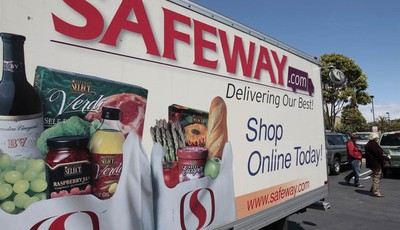 FILE- In this Thursday, April 26, 2012, file photo, a Safeway online shopping advertisement is shown at a Safeway store in San Francisco. Grocery store operator Safeway said Thursday, F