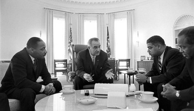 In this image from the LBJ Presidential Library, from left Martin Luther King Jr., President Lyndon B. Johnson, Whitney Young, James Farmer attend a meeting on Civil Rights in the Oval